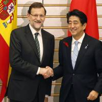 Amigos: Spanish Prime Minister Mariano Rajoy is greeted by Prime Minister Shinzo Abe prior to their Thursday meeting in Tokyo during the Madrid leader's three-day official visit to Japan. | POOL