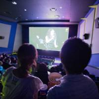 Alternative venue: The audience at a movie theater in Ichikawa, Chiba Prefecture, watches live footage broadcast from a concert by popular pop singer Juju. | KYODO