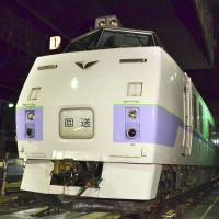 Safety catch: A JR Hokkaido employee walks beside the Okhotsk express Tuesday in a depot in Sapporo. The diesel recently went on several runs between Sapporo and Abashiri, Hokkaido, with an automatic brake effectively disabled. | KYODO