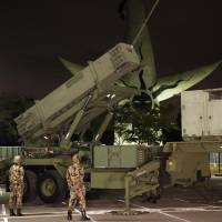 Lock and load: A Patriot anti-missile battery is set up by the Air Self-Defense Force in Expo Park in Suita, Osaka Prefecture, during a drill Wednesday night. | KYODO
