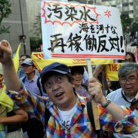 Resistance: Protestors raise signs and shout during an antinuclear demonstration in Tokyo on Sunday. | AFP-JIJI