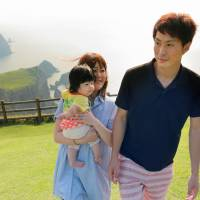 Masaru Watanabe, a crewman on the Ichimaru, accompanies his wife, Mai, and their daughter to the Matengai cliff, one of the tourist spots on Nishinoshima. | KYODO