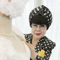 Here comes the dress: Yumi Katsura, a bridal fashion designer, shows off one of her wedding dresses. | KYODO