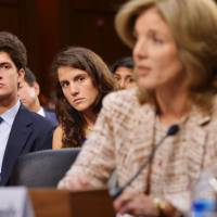 Family support: John 'Jack' Schlossberg and his sister, Tatiana, watch their mother, Caroline Kennedy, testify before the Senate Foreign Relations Committee in Washington on her nomination to be ambassador to Japan.   AFP-JIJI