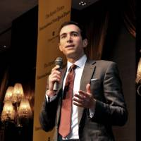 Launch party: New York Times columnist Andrew Ross Sorkin speaks at an event Wednesday in Tokyo to mark the launch of the publishing tie-up between the International New York Times and The Japan Times. | YOSHIAKI MIURA