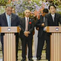 Full-on Fukushima : Foreign Minister Fumio Kishida (right) speaks to reporters at a news conference Saturday following a Pacific Islands Forum meeting in Tokyo.   KYODO