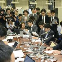 In the hot seat: Mizuho Bank President Yasuhiro Sato addresses the media on Monday evening in Tokyo. | KYODO