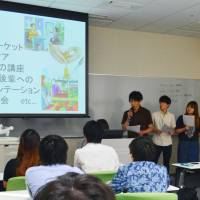 Building experience: Senshu University students make a presentation in July of university dorm construction plans under an internship program for a dormitory operator in Kawasaki. | KYODO