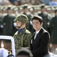 Hail to the chief: Prime Minister Shinzo Abe inspects the Ground Self-Defense Force's Camp Asaka in Saitama on Sunday | KYODO