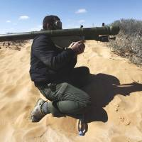 In the wrong hands: A Libyan rebel aims an SA-7 shoulder-fired anti-aircraft missile launcher in the oil town of Ras Lanouf in March 2011. A new independent report warns the Syrian government's arsenal of 20,000 portable anti-aircraft missiles are at risk of falling into the hands of terrorist groups | AP