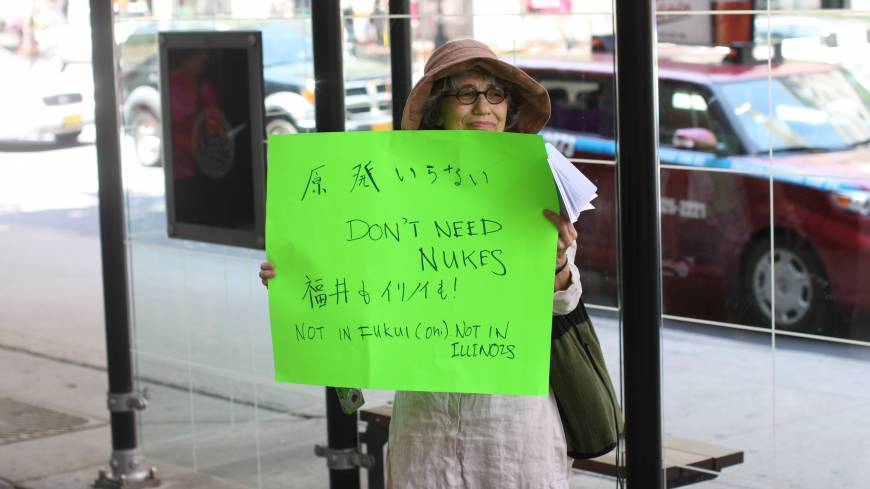 Outspoken: Norma Field holds a sign protesting nuclear energy in downtown Chicago last summer. |  DREUX RICHARD