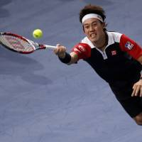 Impressive win: Kei Nishikori plays a shot from Jo-Wilfried Tsonga in their second-round Paris Masters match on Wednesday | AP