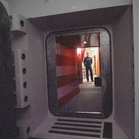 Caught off guard: A U.S. Air Force missile crew commander stands at the door of his launch capsule 30 meters underground, where he and his partner are responsible for 10 nuclear-armed ICBMs, in north-central Colorado in April 1997   AP