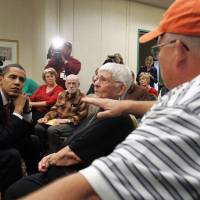 The nuclear waste state: In Naperville, Illinois, in December 2006, Sen. Barack Obama listens to a group of workers from two Illinois nuclear plants who say they were affected by nuclear waste. Obama later gave testimony to the Federal Advisory Board on Radiation and Worker Health | BLOOMBERG