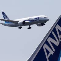 Flying high for now: A Boeing 787 Dreamliner operated by All Nippon Airways comes in for a landing after a test flight at Haneda airport in Tokyo on April 28 | BLOOMBERG
