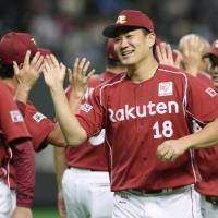Starting pitcher Masahiro Tanaka (18) and his Tohoku Rakuten Golden Eagles teammates celebrate their 11-2 win over the Hokkaido Nippon Ham Fighters on Tuesday at Sapporo Dome. | KYODO