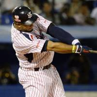 Extending the record: Swallows slugger Wladimir Balentien smacks a sixth-inning home run, his 60th of the season, off Tigers pitcher Randy Messenger on Friday night at Jingu Stadium. Hanshin defeated Tokyo Yakult 3-2 in 12 innings. | KYODO