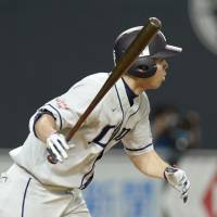 Mind the gap: Seibu's Shogo Akiyama hits a two-run single in the seventh inning of the Lions' 4-3 win over the Fighters on Sunday. | KYODO