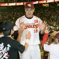 A show of gratitude: Eagles ace Masahiro Tanaka exchanges high-fives with fans after Tuesday's game against the Buffaloes at Kleenex Stadium. Tohoku Rakuten defeated Orix 7-3, with Tanaka winning his 16th consecutive start and 28th consecutive decision. | KYODO