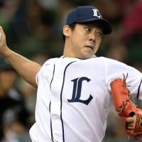 Tunnel vision: Seibu pitcher Yosuke Okamoto delivers during the Lions' 15-0 win over the Marines in Game 2 of the Pacific League Climax Series First Stage on Sunday. | KYODO