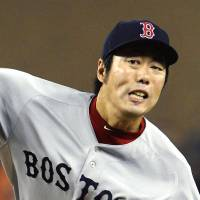 Four-out save: Boston's Koji Uehara fires a pitch against Detroit in the eighth inning of Game 3 of the ALCS on Tuesday night.   KYODO