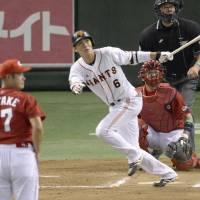 Providing a spark: Giants star Hayato Sakamoto belts a game-tying home run in the sixth inning against the Carp in Game 1 of the Central League Climax Series Final Stage on Wednesday at Tokyo Dome. Yomiuri beat Hiroshima 3-2. | KYODO