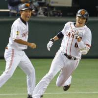 Offensive boost: The Giants' Hayato Sakamoto rounds first base after his fourth-inning hit against the Carp on Friday. | KYODO
