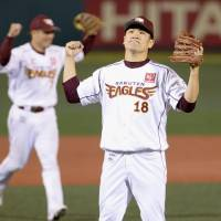 Sweet relief: Tohoku Rakuten's Masahiro Tanaka celebrates victory over the Marines on Monday after entering the game as a reliever in the ninth inning. | KYODO