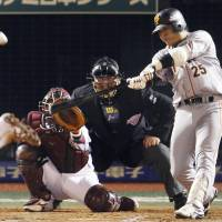 Insurance run: The Giants' Shuichi Murata belts a solo home run in the eighth inning against the Eagles on Saturday. | KYODO