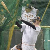 Preparation mode: Giants captain Shinnosuke Abe swings the bat during batting practice on Monday at Tokyo Dome. Abe and the Giants will try to crank up the offense on Tuesday after being held to three hits and one run in a Game 2 loss on Sunday. | KYODO