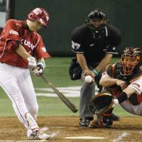 Pivotal hit: The Eagles' Kazuya Fujita lashes a two-run single in the second inning against the Giants on Tuesday in Game 3 of the Japan Series at Tokyo Dome. Tohoku Rakuten had 13 hits in a 5-1 win over Yomiuri. | KYODO