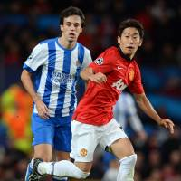 Getting better: Shinji Kagawa runs with the ball against Real Sociedad on Wednesday night. | AFP-JIJI