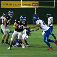 Filling an important role: John Stanton of the IBM BigBlue, in his second season in the X League, is recognized as a valuable pass-catching tight end for the team. | KAZ NATATSUKA