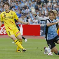 Goal machine: Yoshito Okubo wheels away after scoring the opening goal in Kawasaki Frontale's 3-1 win over Kashiwa Reysol on Sunday. | KYODO