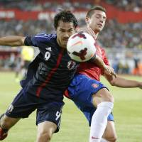 Total concentration: Shinji Okazaki chases the ball during Japan's 2-0 defeat to Serbia in Novi Sad on Friday. | KYODO
