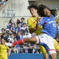 Not this time: Yuji Nakazawa (right) and Yokohama F. Marinos couldn't stop Kashiwa Reysol from advancing to the Nabisco Cup final. Reysol punched a ticket to the final despite a 2-0 Saturday defeat, winning 4-2 on aggregate over two matches.   KYODO