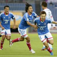 Crunch time:  Marinos winger Manabu Saito (right) celebrates after scoring in Saturday's 1-0 win over Sanfrecce. Marinos lead the J. League by two points with five games left. | KYODO
