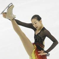 Opportunity knocks: Mao Asada's chances for the gold medal at the Sochi Games could get a boost by a recent injury to defending Olympic and world champion Kim Yu-na. | AP