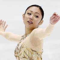 Back home: Miki Ando performs at the Kanto Championships in Yokohama on Sunday. | KYODO