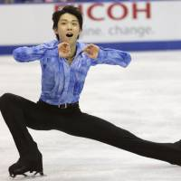 Poised for podium finish: Yuzuru Hanyu competes in the short program at Skate Canada on Friday night in Saint John, New Brunswick. Hanyu is in third place heading into Saturday's free skate.  | KYODO