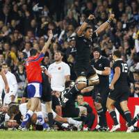 Just done it: New Zealand loose forward Jerome Kaino (jumping), currently playing in the Top League with Toyota Verblitz, celebrates the All Blacks' win over France in the 2011 World Cup final. | KYODO