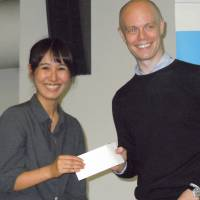 Good results: University of Tokyo student Mugiko Komatsuda (left), who won last week's Science Slam contest in Tokyo, poses with Lee Woolgar from Euraxess Links Japan, a European Commission initiative that organized the all-English contest. | TOMOHIRO OSAKI