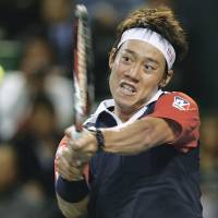 No repeat: Kei Nishikori plays a shot from Spain's Nicolas Almagro in their quarterfinal match at the Rakuten Open on Friday at Ariake Colosseum. Almagro won 7-6 (7-2), 5-7, 6-3. | AP