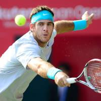 Last man standing: Juan Martin del Potro plays a shot during his 7-6 (7-5), 7-5 win over Milos Raonic in the final of the Japan Open on Sunday.   AFP-JIJI