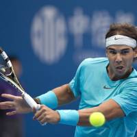 Back for more: Rafael Nadal plays a shot during his 6-3, 6-4 loss to Novak Djokovic in the final of the China Open on Sunday. Nadal and Djokovic could meet again at this week's Shanghai Rolex Masters. | AP
