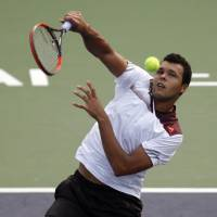 Steady form: France's Jo-Wilfried Tsonga hits a return to Kei Nishikori during their third-round match at the Shanghai Rolex Masters on Thursday. | AP
