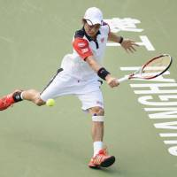 Tough exit: Kei Nishikori, competing against France's Jo-Wilfried Tsonga on Thursday, falls 7-6 (7-5), 6-0 in the third round of the Shanghai Rolex Masters. | KYODO
