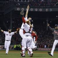 Boston Strong: Koji Uehara (left) jumps into the arms of catcher David Ross as the Red Sox celebrate after winning the 2013 World Series on Wednesday at Fenway Park. | AP