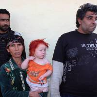 Meet the family: Sasha and Atanas Ruseva are seen with one of their children in the Roma district of the Bulgarian town of Nikolaevo on Thursday | AFP-JIJI