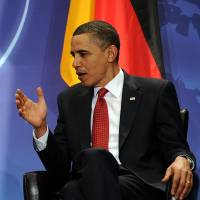 Speaking terms: U.S. President Barack Obama speaks with German Chancellor Angela Merkel during a bilateral meeting on the sidelines of the Nuclear Security Summit in Washington in April 2010. Obama administration officials denied Sunday that the U.S. leader knew about alleged spying on Merkel | AFP-JIJI